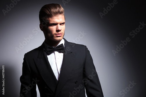 attractive young man wearing elegant black suit and bow tie