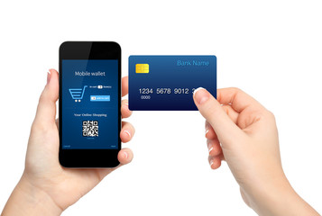female hands holding phone and credit card making a purchase onl