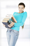 Student woman holding heavy books