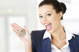 Attractive businesswoman holding a house key