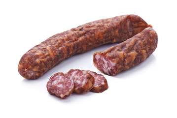 Sliced dried salami isolated on white background
