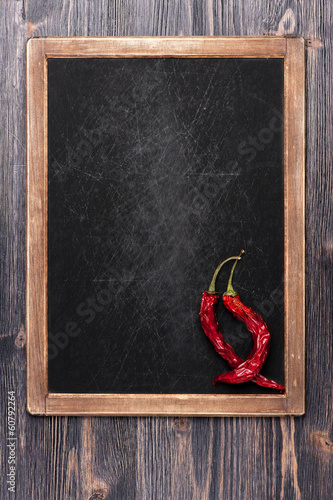 Hot red chili peppers and vintage chalk board menu