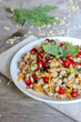 Warm salad with barley, carrot, pomegranate seeds