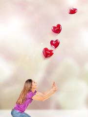 Frau fängt Herzen