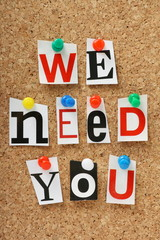 We Need You on a cork notice board