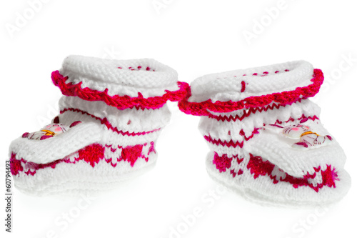 a pair of small warm bootees for girl on a white background