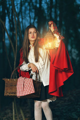Little Red riding hood alone in the dark forest