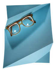 High diopter retro eyeglasses on blue creative support