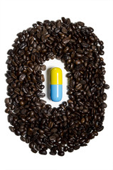 Pill surrounded by coffee beans