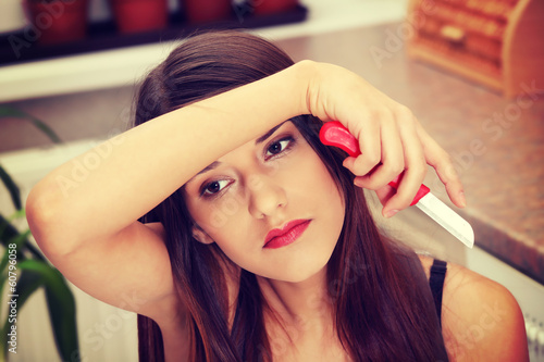 Young woman peeling potato