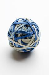 Rubber band ball stuck with thumbtacks