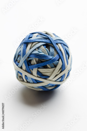 Rubber band ball stuck with thumbtacks