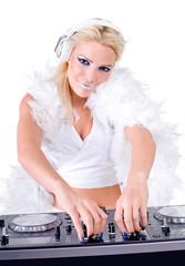 Beautiful Sexy Young Woman as DJ playing music on (pickup) mixer