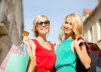 beautiful women with shopping bags in the ctiy