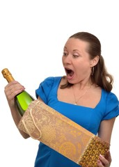 Woman enjoys receiving a gift of expensive champagne