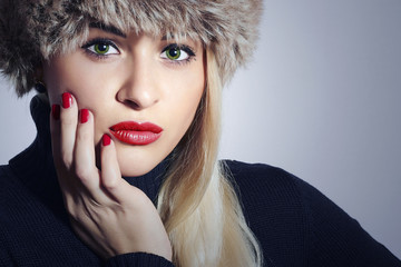 Beautiful Blond Woman in Fur.Girl with Green Eyes and Red Lips
