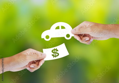 Hand with paper money and car shape. new car buy concept