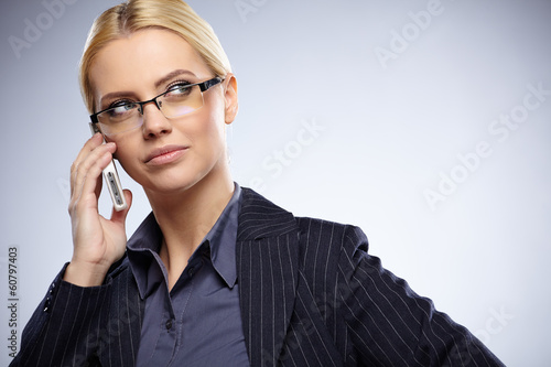 successful businesswoman with cell phone, isolated on white bac