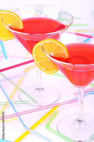two glasses with red cocktail vertical