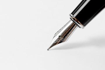 Fountain pen on white paper.
