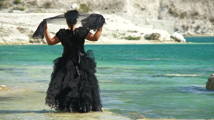 Lady in black on a walk on a lake