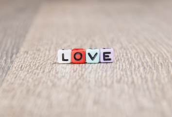 word love is built of colored cubes