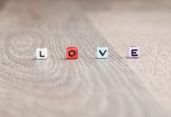 the word love on a wooden surface