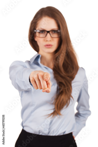Serious girl shows forefinger forward
