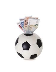Geld. Fußball. Spardose.