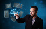 Attractive businessman touching high technlogy cloud service