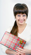 young woman with packaged gift