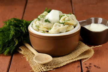traditional Russian dumplings served with dill and sour cream