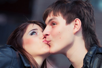 Happy young couple in love kissing