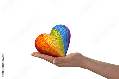 hand with wool heart symbol of peace