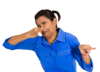 Woman covering nose, can't tolerate bad smell