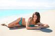 Asian brunette girl lying on the summer beach white sand
