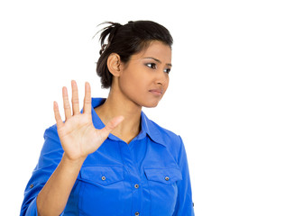 Woman bad attitude giving talk to hand gesture palm outward