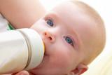 Bond little baby blue eyes drinking bottle milk