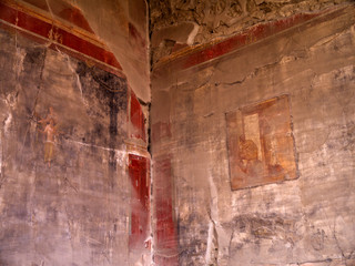 Ruined fresco in the once buried city of Pompeii Italy