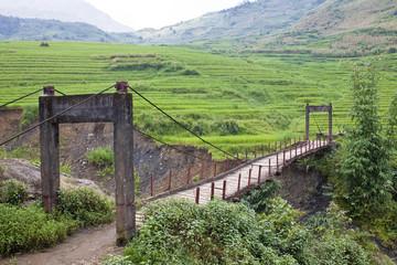 An old wooden foot bridge near Sapa in Vietnam
