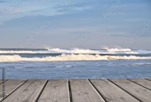 Fotobehang Een Hoekje om te Dromen olas tras el embarcadero