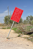 Signboard warning about entrance to palestinian village.Israel