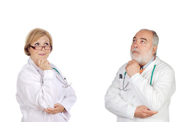 Experienced team of doctors thinking