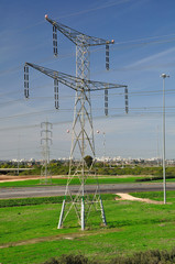 Massive electric pylon on the lawn near the highway. Israel.