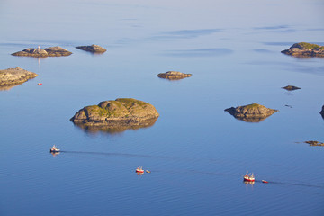 Fishing boats and tiny islands