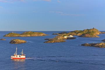 Fishing boat and tiny islets