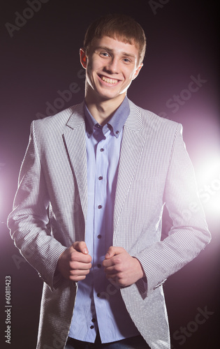 Young Happy Man Over a Black Background