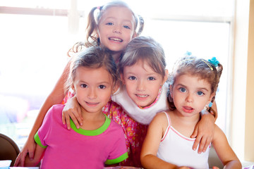 sister and friends kid girls in hug happy together