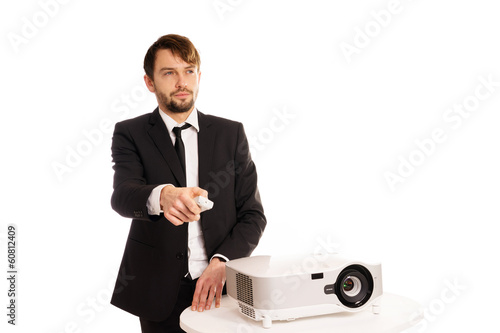 Businessman using a projector for a presentation