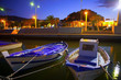 Denia port marina with traditional llaut boats at sunset night